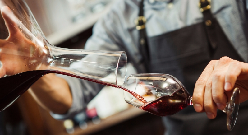 Sommelier Decanting Red Wine
